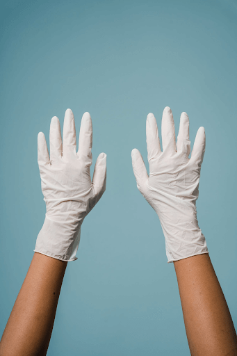 hands with white gloves in a blue background